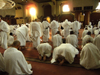Mecca / Makkah, Saudi Arabia: group of hajj pilgrims prays in Tanae'im mosque, about 5 km from Haram Mosque - Ihram clothing - Tanae'im Mosque is the nearest halal area before the start of Umra, the smaller pilgrimage - photo by A.Faizal